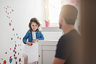 Girl with father decorating wall in children's room - DIGF000971