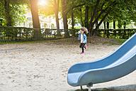 Girl running on playground - DIGF001007