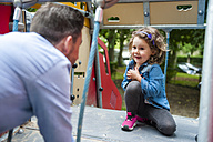 Father with daughter on playground - DIGF001025