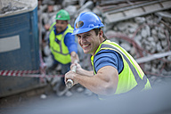 Smiling construction worker on construction site - ZEF009434