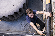 Spain, Madrid, man climbing, during a parkour session - ABZF001000