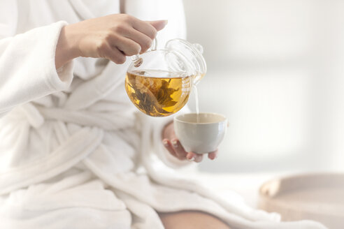 Close-up of woman in spa having tea - ZEF009602