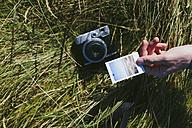Man's hand holding polaroid - BOYF000536