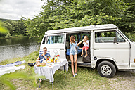 Family with van at lakeside - FMKF002834