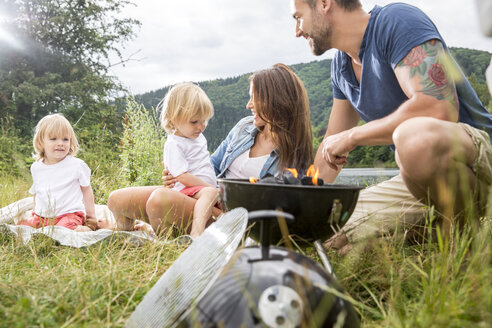 Family having barbecue on a meadow - FMKF002852