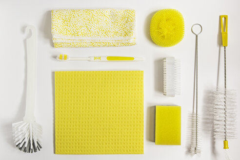 Yellow cleaning utensils on white background - MELF000135