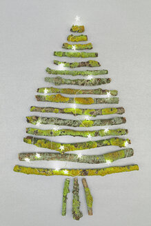 Christmas tree shaped of mossy branches and Christmas decoration - GWF004878