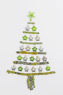 Christmas tree shaped of mossy branches and Christmas decoration - GWF004881