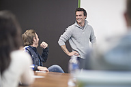 Young business people discussing in business meeting - ZEF009770