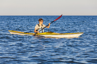 Denmark, Young man kayaking - WDF003725