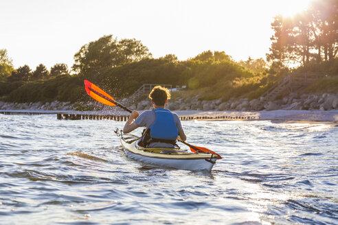 Denmark, Young man kayaking - WDF003728