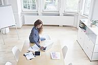 Woman using laptop in boardroom - RBF005016