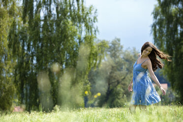 Young woman, blue dress, on meadow - MAEF011935