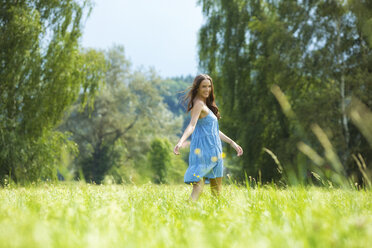 Young woman, blue dress, on meadow - MAEF011938