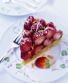 Piece of layered strawberry cake with pine nuts and chocolate icing - PPXF000035