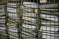 Pile of office files behind grid - ASF005999