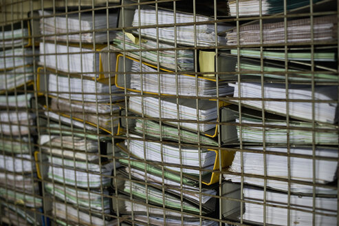 Pile of office files behind grid - ASF005999