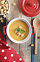 Pot of creamed pumpkin soup with bread cubes - RTBF000275