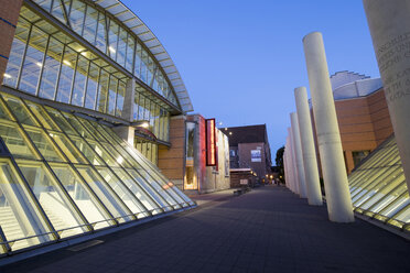 Germany, Nuremberg, view to lighted glass facade of Nationalmuseum and Way of Human Rights - SIE007089