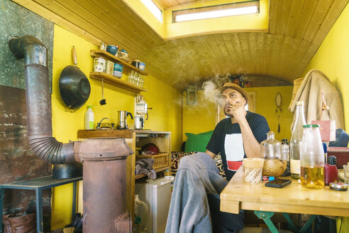 Smoking inhabitant of a caravan community - TAMF000563