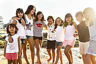 Group of kids on the beach at sunset - MGOF002263