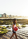 Girl playing with a ball on the beach at sunset - MGOF002275