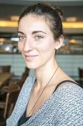 Portrait of smiling woman in a coffee shop - TAMF000565