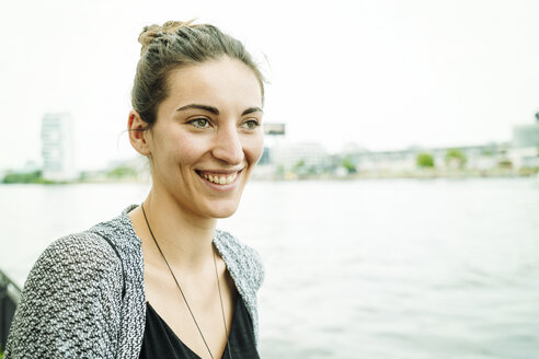 Portrait of smiling young in front of river - TAMF000571