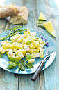 Melon salad, yellow watermelon, feta, mint and rocket on plate - MAEF011957