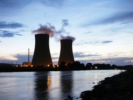 Germany, Lower Saxony, Grohnde, Grohnde Nuclear Power Plant along the Weser river during sunset - HAWF000956