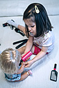 Girl playing with doll and hairdressing toys - DAPF000311