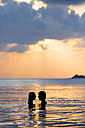 Couple, face to face, silhouettes at sunset - SBOF000180