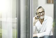 Portrait of smiling man on the phone - SBOF000207