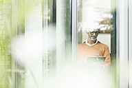 Man using tablet at home - SBOF000213