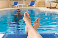 Woman's feet at swimming pool - SKCF000187