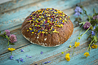 Flower bread on blue wood - MAEF011982
