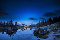 Italy, Veneto, Dolomites, Lake Federa and Croda da Lago mountain hut by night - LOMF000377