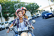 Young couple driving on a motorbike - KIJF000730