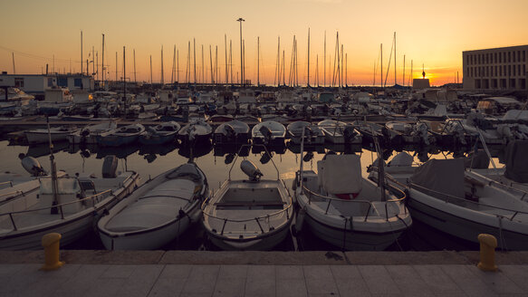 Italy, Livorno, moored motorboats and sailing boats at the port by  evening twilight - OPF000123