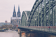 Germany, Cologne, woman taking picture at Hohenzollern Bridge - RTBF000282