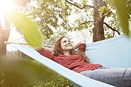 Smiling woman relaxing in hammock - RBF005075