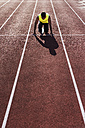 Runner on tartan track in starting position - UUF008294