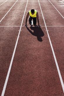 Runner on tartan track in starting position - UUF008294