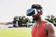Athlete wearing virtual reality glasses - UUF008315