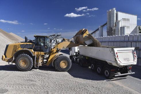 Wheel loader loading gravel on truck - LYF000576