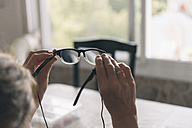 Woman's hands holding spectacles - SKCF000191