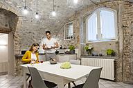Couple in kitchen preparing fruit salad - DIGF001142