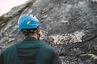Climber looking up a rock wall - RAEF001461