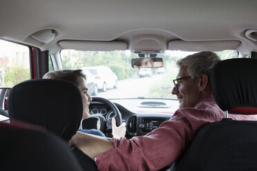 Father teaching son driving a car - RBF005155