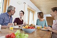 Happy family having breakfast at home - RBF005158